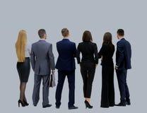 Équipe réussie d'affaires semblant l'arrière ascendant de position Photographie stock libre de droits