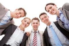 Équipe sûre d'affaires faisant le petit groupe Images stock