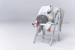 Équipement de clôture professionnel sur la chaise Photos libres de droits