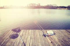 Équipement de pêche modifié la tonalité par vintage Image stock