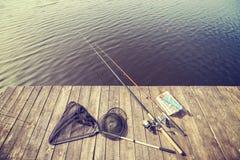 Équipement de pêche modifié la tonalité par vintage Photo stock