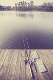 Équipement de pêche modifié la tonalité par vintage Images stock