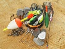 Équipement de pêche sur en bois Photographie stock