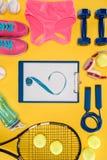Équipement de sport sur le fond orange Photo libre de droits