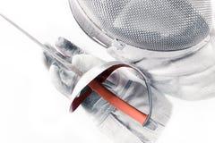 Équipement, masque, gant professionnel et rapière de clôture d'isolement Photographie stock