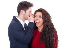Équipez chuchoter un secret à un ady étonné Image libre de droits