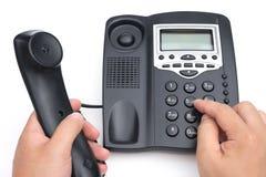 Équipez composer un téléphone noir sur le fond blanc photographie stock libre de droits