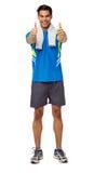 Équipez dans l'habillement de sports faisant des gestes des pouces  Photo libre de droits