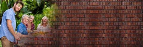 Équipez faire cuire le BBQ pour la transition de famille et de brique rouge Photographie stock libre de droits