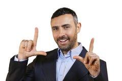 Équipez faire un geste de cadre avec ses doigts photos libres de droits