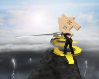 Équipez l'équilibre de maison en bois de prise sur la main d'horloge d'USD sur la montagne Photos libres de droits