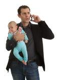 Équipez la jonglerie en étant homme d'affaires et un père Images libres de droits