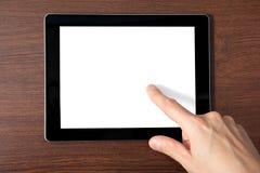 Équipez la main retenant une tablette avec un écran d'isolement photo libre de droits
