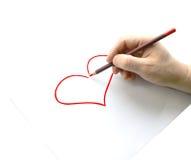 Équipez le crayon de prise sur la main droite, isolement sur le fond blanc Photo stock