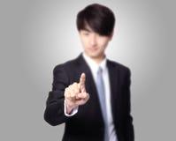 Équipez le doigt poussant la surface adjacente d'écran tactile Photos stock