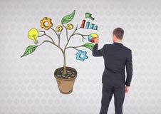 Équipez le stylo de participation et le dessin des graphiques de gestion sur des branches d'usine sur le mur Images libres de droits