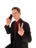 Équipez le téléphone portable de fixation Photo libre de droits