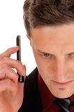 Équipez le téléphone portable de fixation Photo stock