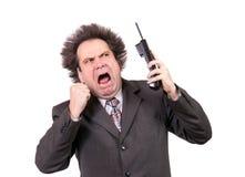 Équipez les cris dans un téléphone Images libres de droits