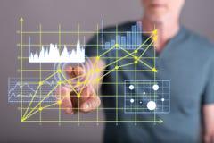 Équipez les graphiques de gestion émouvants sur un écran tactile Photographie stock libre de droits