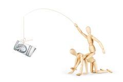 Équipez les tours sur une autre personne et le taquinez avec un rouleau de dollars Images libres de droits