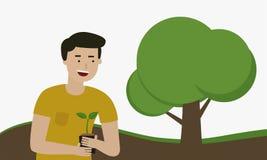 Équipez planter un arbre pour des économies le monde Photo libre de droits