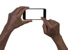 Équipez prendre une photo utilisant un téléphone intelligent Images stock