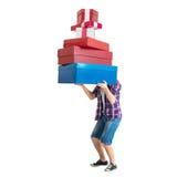 Équipez tenir beaucoup de cadeau coloré et lourd de sacs Photo libre de droits