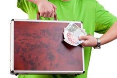 Équipez tenir et montrer une serviette et un argent Images stock