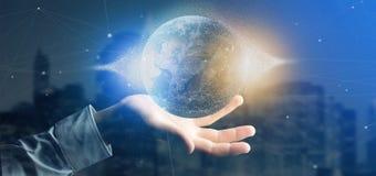Équipez tenir un globe de la terre de particules du rendu 3d Photos libres de droits