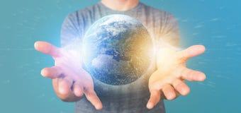 Équipez tenir un globe de la terre de particules du rendu 3d Photo libre de droits