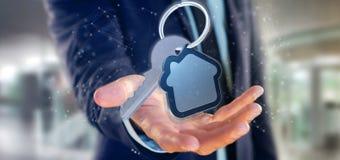Équipez tenir une clé et un rendu de la maison 3d Photo stock
