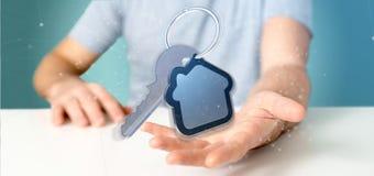 Équipez tenir une clé et un rendu de la maison 3d Image stock