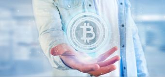 Équipez tenir une icône de Bitcoin de technologie sur un rendu du cercle 3d Image stock