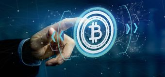 Équipez tenir une icône de Bitcoin de technologie sur un rendu du cercle 3d Images libres de droits
