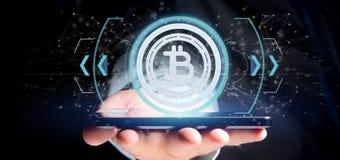 Équipez tenir une icône de Bitcoin de technologie sur un rendu du cercle 3d Photographie stock