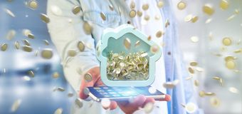 Équipez tenir une tirelire de Chambre avec la pièce de monnaie entourant partout dans 3d r Images libres de droits