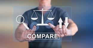 Équipez toucher un concept de comparer sur un écran tactile images stock