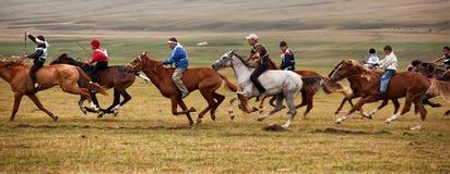 équitation nationale de nomade de cheval traditionnelle Photos libres de droits