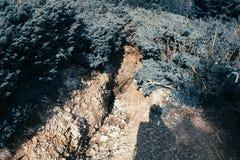 Érosion du sol sur des flancs de coteau photos stock