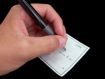 Établissement d'un chèque photos stock