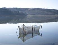 Étang d'élevage pour des poissons dans le lac Image libre de droits