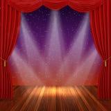 Étape avec les rideaux et le projecteur rouges Image stock