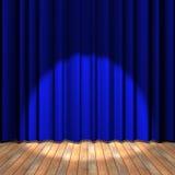 Étape bleue de rideau avec une lumière d'endroit Photo stock