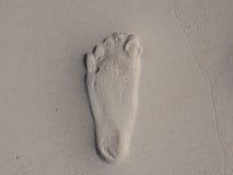 Étape de pied sur le sable Photo stock