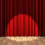 Étape rouge de rideau avec une lumière d'endroit Photo libre de droits