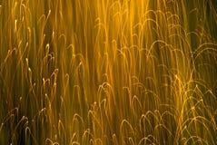 Étincelles abstraites intéressantes d'orange de fond Photos stock