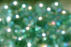 Étincelles avec le fond de vert de lite photo stock