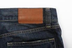 Étiquette blanc de jeans Photos libres de droits