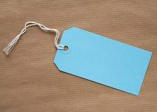 Étiquette bleue de cadeau Photo libre de droits
